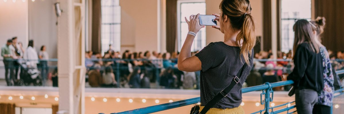 event-venue-woman-taking-a-picture-of-an-event-ven-72KYXHF